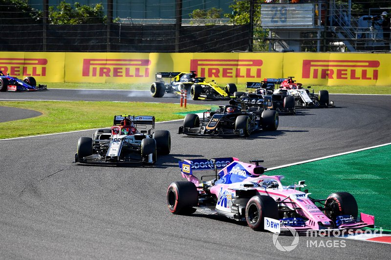 Sergio Perez, Racing Point RP19, leads Antonio Giovinazzi, Alfa Romeo Racing C38, Kevin Magnussen, Haas F1 Team VF-19, Romain Grosjean, Haas F1 Team VF-19, Kimi Raikkonen, Alfa Romeo Racing C38, and Daniel Ricciardo, Renault F1 Team R.S.19