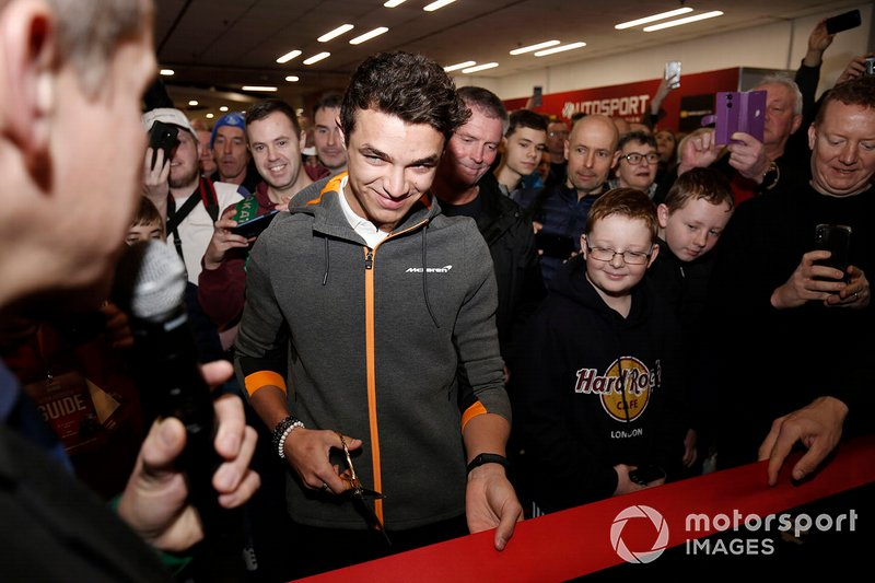 Lando Norris prepares to cut the ribbon and open Autosport International 2020