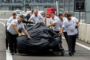 Mercedes mechanics return the damaged car of Valtteri Bottas, Mercedes AMG W10, to their garage after his crash at the end of Qualifying