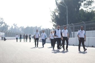 Members of BMW I Andretti Motorsports team on the track walk