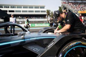 A mechanic works on one of the Mercedes Benz EQ, EQ Silver Arrow 01s on the grid