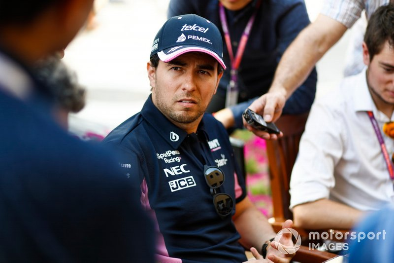 Sergio Perez, Racing Point, talks to the media