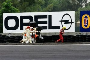 Ayrton Senna walks away from his McLaren MP4-6 Honda, after spectacularly rolling over at the Peraltada
