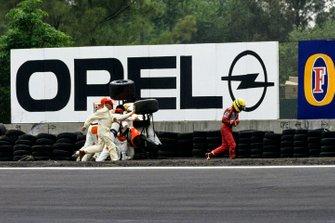 Ayrton Senna walks away from his McLaren MP4-6 Honda, after spectacularly rolling over at the Peraltada