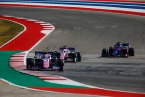 Lance Stroll, Racing Point RP19, leads Sergio Perez, Racing Point RP19, and Daniil Kvyat, Toro Rosso STR14