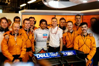 Carlos Sainz Jr., McLaren, poses with colleagues