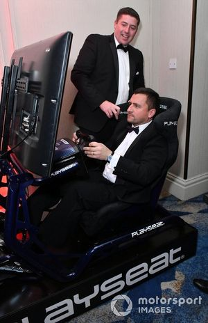 Some guests try out a racing simulator