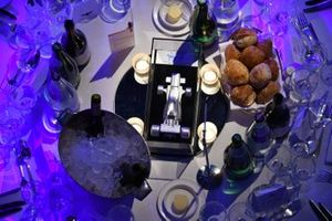 Set tables prior to the arrival of the guests include pewter centrepieces