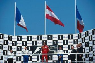 Podium: Race winner Gerhard Berger, Ferrari, Olivier Panis, and Eric Bernard, Ligier