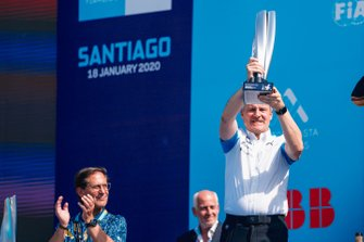 Jens Marquardt, BMW Motorsport Director holds the race winning trophy on the podium