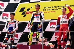 Podium: winner Valentino Rossi, Honda Team, second place Tohru Ukawa, Repsol Honda Team, third place