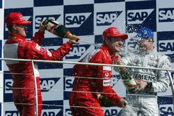 Michael Schumacher, Ferrari; Rubens Barrichello, Ferrari; David Coulthard, McLaren