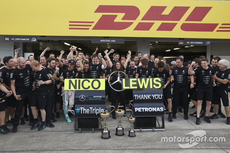 Nico Rosberg, Mercedes AMG F1 and team mate Lewis Hamilton, Mercedes AMG F1 celebrate the Constructo