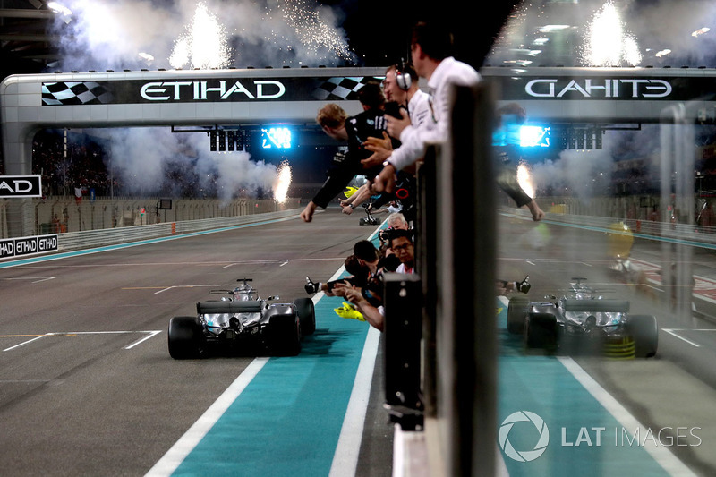 Valtteri Bottas, Mercedes-Benz F1 W08 and Lewis Hamilton, Mercedes-Benz F1 W08 cross the line