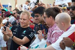 Valtteri Bottas, Mercedes AMG F1, takes a photo, fans