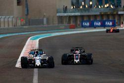 Lance Stroll, Williams FW40 leads Romain Grosjean, Haas F1 Team VF-17