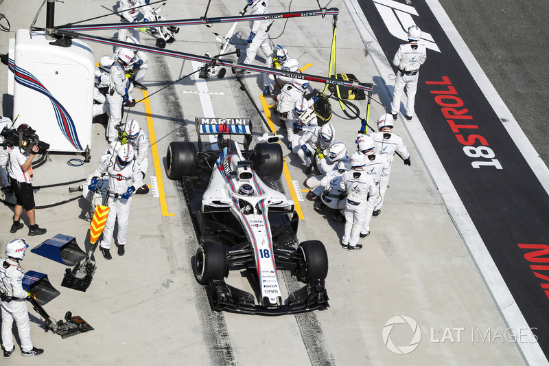 Lance Stroll, Williams FW41 Mercedes, leaves his pit box after a stop