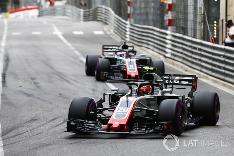 Kevin Magnussen, Haas F1 Team VF-18, leads Romain Grosjean, Haas F1 Team VF-18