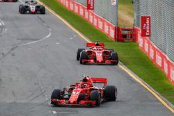 Kimi Raikkonen, Ferrari SF71H, leads Sebastian Vettel, Ferrari SF71H, and Kevin Magnussen, Haas F1 Team VF-18 Ferrari