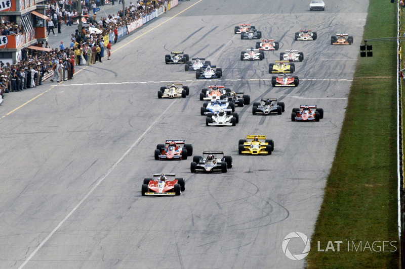 Gilles Villeneuve, Ferrari Ferrari 312T3 leads the original start of the race from pole sitter Mario