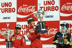 Podium: race winner Alain Prost, McLaren, second placed Michele Alboreto, Ferrari, third placed Elio