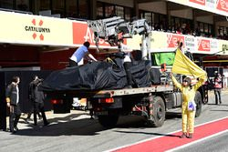 The car of Fernando Alonso, McLaren MCL33 is recovered to the pits