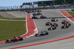 Sebastian Vettel, Ferrari SF70H leads Lewis Hamilton, Mercedes-Benz F1 W08 at the start of the race