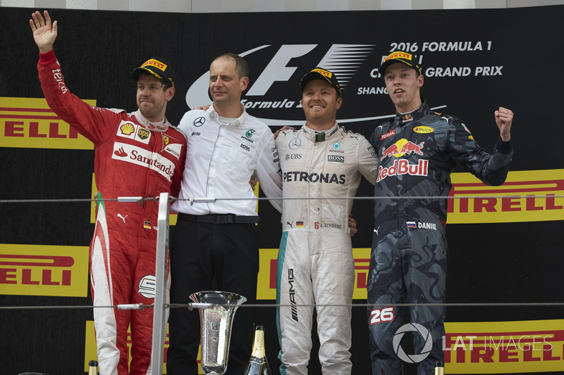 Second place Sebastian Vettel, Ferrari, Tony Ross, Race Engineer, Mercedes AMG F1, Nico Rosberg, Mercedes AMG F1, race winner, Daniil Kvyat, Red Bull Racing, third place, on the podium