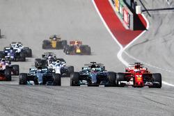Lewis Hamilton, Mercedes AMG F1 W08, Sebastian Vettel, Ferrari SF70H, battle at the start of the race
