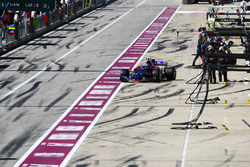Daniil Kvyat, Scuderia Toro Rosso STR12, leaves his pit box after a stop