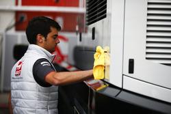A Haas team member cleans the motorhome