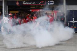 Ferrari garage and smoke