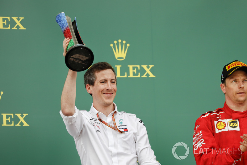 The Mercedes delegate lifts the Constructors trophy alongside Kimi Raikkonen, Ferrari, 2nd position, on the podium
