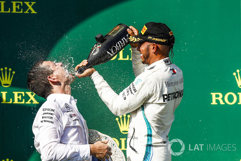 Lewis Hamilton, Mercedes AMG F1, 1st position, pours Champagne over his team mate on the podium