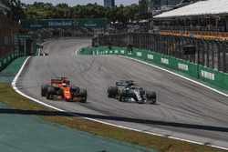 Fernando Alonso, McLaren MCL32 and Lewis Hamilton, Mercedes-Benz F1 W08  battle for position