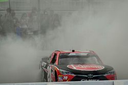 Christopher Bell, Joe Gibbs Racing, Toyota Camry Rheem celebrates with a burnout after winning