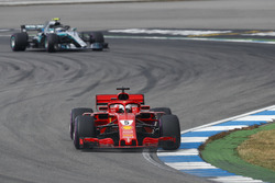 Sebastian Vettel, Ferrari SF71H, leads Valtteri Bottas, Mercedes AMG F1 W09
