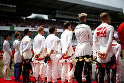 The drivers stand to attention for the national anthem L-R: Kevin Magnussen, Haas F1 Team, Nico Hulkenberg, Renault Sport F1 Team, Charles Leclerc, Sauber, Fernando Alonso, McLaren, Marcus Ericsson, Sauber, Daniel Ricciardo, Red Bull Racing, Pierre Gasly, Toro Rosso, and Lance Stroll, Williams