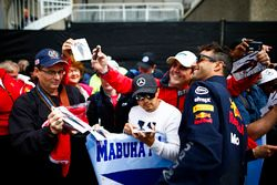 Daniel Ricciardo, Red Bull Racing, poses for a picture with fans