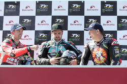 Michael Dunlop celebrates winning his third TT of the week in the Lightweight race with runner up Derek McGee and third placed Michael Rutter