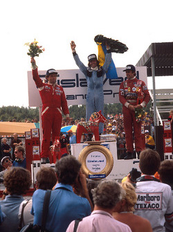 Podium: race winner Jacques Laffite, Ligier, second place Jochen Mass, McLaren, third place Carlos Reutemann, Ferrari