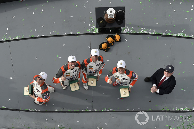 #54 CORE autosport ORECA LMP2, P: Jon Bennett, Colin Braun, Romain Dumas, Loic Duval celebrate in victory lane with Rolex watches