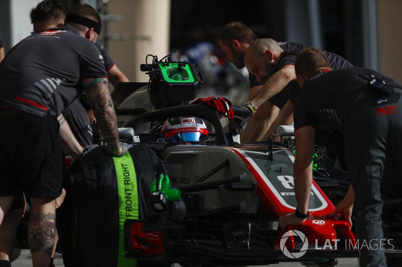 Romain Grosjean, Haas F1 Team VF-18 Ferrari, is returned to the garage