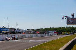 #54 CORE autosport ORECA LMP2, P: Jon Bennett, Colin Braun, Crosses the Start / Finish Line under the Checkered Flag