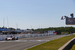 #54 CORE autosport ORECA LMP2, P: Jon Bennett, Colin Braun, Crosses the Start / Finish Line under the Checkered Flag