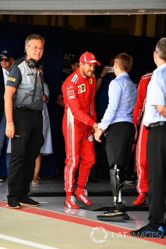 Sebastian Vettel, Ferrari with Billy Monger, in parc ferme