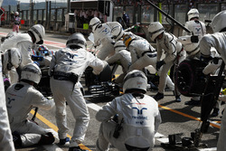 Guy Martin joins the Williams F1 pit crew during the race in the position of left rear off