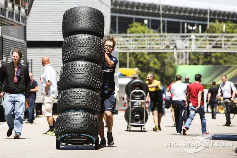Sauber team member, tyres in the paddock