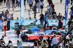 Felix Rosenqvist, Mahindra Racing, walks away asSébastien Buemi, Renault e.Dams, celebrates in Parc
