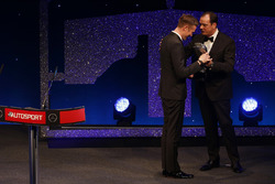 Gordon Shedden is presented with the National Driver of the Year Trophy